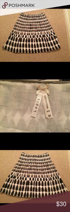Black and white lapis skirt; petite medium. Black and white lapis skirt; petite medium. Price is negotiable. Lapis Skirts