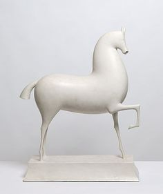 "1915 ""Horse"". Elie Nadelman was an American sculptor, draughtsman & collector of Polish birth. The plaster Horse has survived as one of the most important works from his early period in Paris. Its fluent geometry, that taut answering of curve and countercurve, created, 'a new life which had nothing to do with nature'. The plump, buoyant profile of the horse also anticipates the painted wooden carvings of society figures which Nadelman later made in the United Sates"