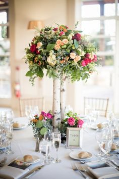 Tall Rustic Wooden Centerpiece With Pink Flowers And Greenery