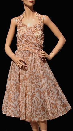 1950s nylon chiffon halter dress with tan brown leaf print. Looks nice and breezy.