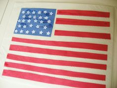 """Flag Place Mat *Paper Towel *Red, White & Blue paper *Star Paper Punch *Scissors *Glue *Clear Contact Paper ~Cut blue paper in rectangle that takes up almost a 1/4 of upper left corner ~Punch stars from white paper & Glue on blue paper ~Cut red paper in stripes & Glue on white paper ~Let dry completely ~Cover w/contact paper - works best by placing contact paper on table & lay flag face down so there are no bubbles, then sandwich it w/another piece. Press hard & trim so there is 1/2"""" edge."""