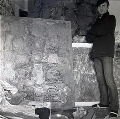 Stuart Sutcliffe with one of his abstract paintings.