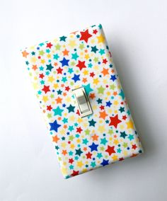 Star Light Switch Plate Cover / Nursery Decor / Kids Room / Baby Gender Neutral / Pierres Famous Traveling Circus / Starlettes Multi. $10.00, via Etsy.