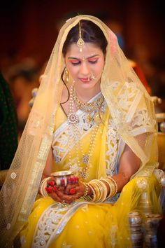 Top wedding photographer -mumbai-grand-hyatt--bride-yellow-saree by Anoop Photography