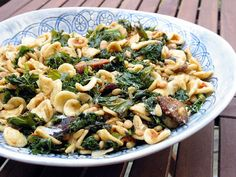 orecchiette with sausage and kale -- this was really good -- i used spicy chicken sausage from TJs and added cannellini beans.  filling and good :)