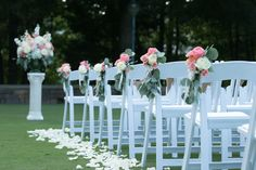 Coral, peach and white flowers for aisle and pedestal arrangement for ceremony