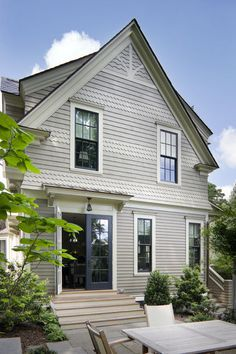 Using gray on gray creates a subtle distinction between body and trim, like a gray pin-striped suit with gray piping. These darker window frames in a deep blue-gray contrast with the adjacent lighter gray trim.