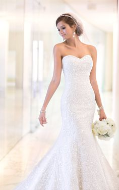 Lace over Dolce Satin wedding dresses shine with a figure-flattering fitted bodice and dramatic court train. Exclusive designer wedding dresses by Essense of Australia.
