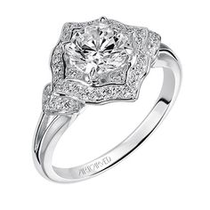 My my Martina! This contemporary Halo engagement ring features a polish split shank. It has a vintage sensibility but is quite chic for the bride craving something different!