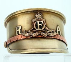 'A British 4.5' Howitzer shell case base made into an Army Service cap with the badge and shoulder title of the Royal Field Artillery. Trench Art' - pin by Paolo Marzioli