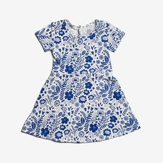 A beautiful field of bright blue wildflowers on creamy white. Features soft neck binding, buttons down the back bodice for easy over the head, and a full skirt