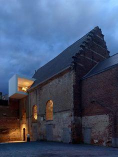 Klaarchitectuur inserts new architecture studio inside dilapidated Belgian chapel