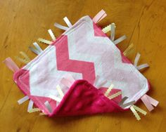 Check out this item in my Etsy shop https://www.etsy.com/listing/234409272/pink-chevron-crinkle-sensory-tag-blanket