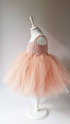 Dreamy ballerina-inspired dress featuring a ruffly petals tulle skirt. Flower Girl Tulle Dress with Lace Stretch Crochet Bodice