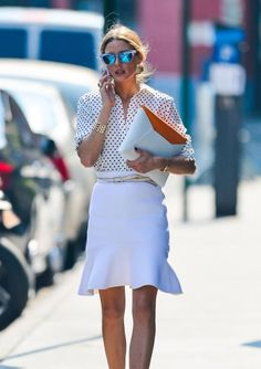 White-on-white is a clean-cut and modern combo for summer. Palermo added pops of color so using a clutch with a punch of orange and sunglasses with blue mirror lenses. #OliviaPalermo #Fashion