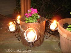 Simply take some old bed springs, wire them to the sides of a bucket or planter. Slip in a glass votive holder and a candle