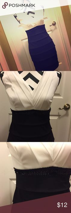 NWT Black/White party body on style dress Never worn. Tags still on it. Black and white party dress. Very fitting. Bodycon style. No zippers or button. Over the top slid in dress. Dresses Mini