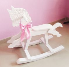 Shabby chic vintage nursery rocking horse for a girl or a boy, just change the bow color to pink or blue! It was an old horse wich I repainted in white! That's all! Simple and cute