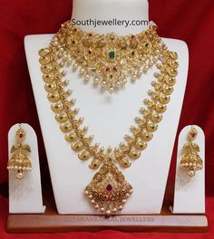 22 carat gold antique nakshi bridal set adorned with cz stones, rubies, emeralds and pearls by Sri Mahalaxmi Jewellers & Pearls. Gold Temple Jewellery, Fancy Jewellery, Gold Wedding Jewelry, Bridal Jewelry Sets, Gold Jewelry, Bridal Sets, Indian Jewelry Sets, India Jewelry, Gold Necklaces