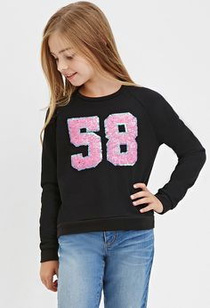 Girls Sequined 58 Graphic Sweatshirt (Kids)   I just bought this for my daughter she loves it and It is super cute on her.