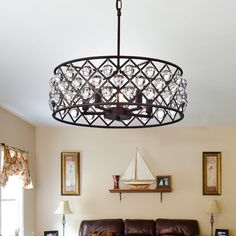 Features:  -Light direction: Multi-directional.  -Switch type: Hardwired.  -Made in the USA.  Product Type: -Drum chandelier.  Finish: -Brown.  Material: -Metal.  Number of Lights: -5.  Wattage: -60 W
