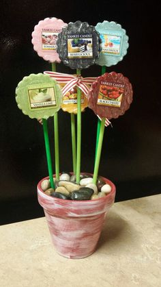Yankee Candle wax tart bouquet for the stepmom for Mother's Day! Painted/white washed terracotta pot - Yankee Candle wax tarts * painted dowels * ribbon * craft foam * rocks