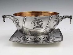 A rare Tiffany antique sterling bowl and plate with applied Japanese style decoration. The pierced handles have applied work and two square silver links suspended from the tips. Designed by Edward Moore and marked with the Union Square mark of Tiffany and Company. The plate is inscribed and dated 1886.