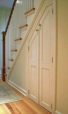 Hidden door to storage toby leary fine woodworking for Door under stairs