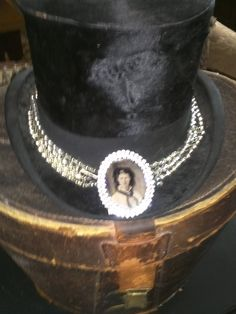 Necklace adorned black top hat