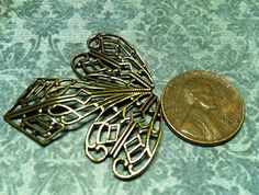 trinity brass stamping filigree angel or fair wings by mkpdestash, $1.75