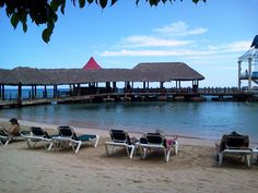 A view of the beach at Ochi Beach Club, Sandals Grande Riviera Beach & Villa Resorts, Ocho Rios, Jamaica.#caribbeanresort
