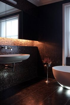 We love the low lighting in this bathroom. It has charm and looks insanely luxurious.