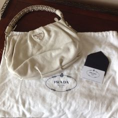 Prada Shoulder Bag Beautiful cream metallic leather shoulder bag with silver tone hardware. Top zip closure. Interior zip pocket and fabric lining. In excellent condition. Prada Bags Shoulder Bags