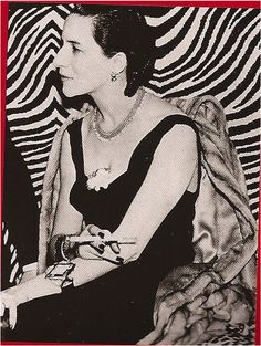 Diana Vreeland dressed in Schiaparelli at El Morocco, 1938. Photo by Jerome Zerbe.