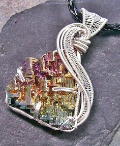 Woven Wire Bismuth Crystal Pendant In Silver--really awesome flowing form around the boxy crystals of bismuth :D