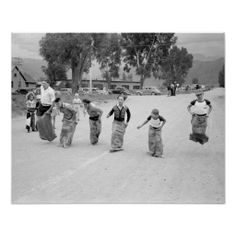 A group of boys compete in a sack race during the Labor Day celebration. Ridgway, Colorado. 1940.