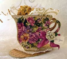 Tea cup cookie holder out of patterned paper. Cookie in a pocket on back