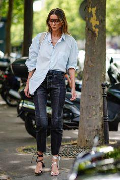 Julia Pelipas wears sunglasses a blue shirt black pants black and white heels shoes outside the Zuhair Murad show during Paris Fashion Week Haute...