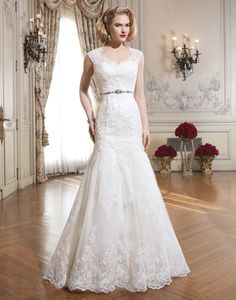 Justin Alexander wedding dresses style 8689 This lace and tulle mermaid gown has a charming sweetheart neckline. It  features a Queen Anne cap sleeve tulle and lace jacket with a lustrous  beaded trim at the natural waistline and fabric buttons that enclose the  jacket.