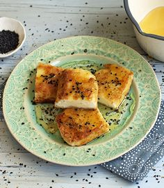 This is the way to cook halloumi. Served like this, dusted in semolina, fried in olive oil and drizzled with warm honey, black sesame seeds and oregano, it really is the best
