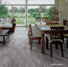 Jenna Sue: tile that looks like wood floors - sunroom!