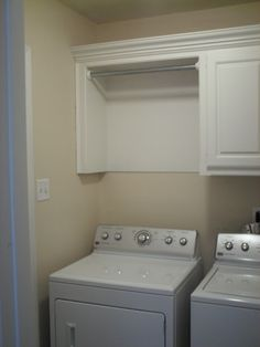 Remodelaholic....love how she updated this laundry space. Love the cabinet and rod combo.