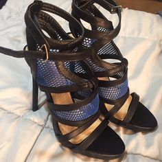 Black/blue heels Heel is approx 4.5 inches, wore these twice , excellent 9/10 condition . Shoes