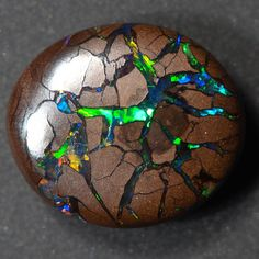 Opal is a hydrated amorphous form of silica; its water content may range from 3% to 21% by weight, but is usually between 6% and 10%. Because of its amorphous character it is classed as a mineraloid, unlike the other crystalline forms of silica which are classed as minerals. It is deposited at a relatively low temperature and may occur in the fissures of almost any kind of rock, being most commonly found with limonite, sandstone, rhyolite, marl and basalt.