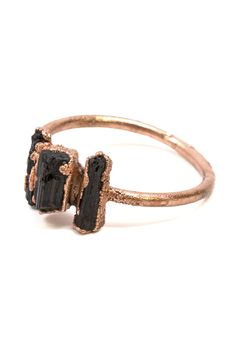 The Black Tourmaline crystals that sit atop this ring are displayed in their natural, raw glory. Without needing to polish or drill the stone, the jewelry technique of electroforming allows this unique statement ring to shine without disturbing or altering the crystals' uninhibited elegance.