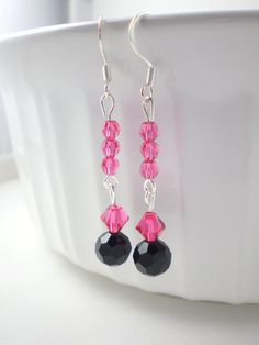 These darling pink and black dangle earrings are made with indian pink swarovski crystals and black glass beads- perfect for a special occasion or every day use. These sweet pink earrings will add a burst of girly sparkle to your day. These earrings are also perfect for the upcoming spring season! They would make a terrific gift for someone special. These earrings come in a cute organza bag ready for gifting.  LENGTH: 2 inches total (ear wire to end of lowest bead)