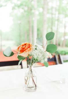 Simple centerpieces with Queen Anne's lace, rose, and eucalyptus // JoPhoto
