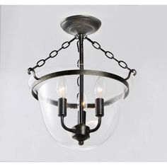 Create a rustic feel to any room in your home with this beautiful glass lantern chandelier. It has an antique copper finish, for added elegance, and it has a stylish clear glass shade, which helps distribute light brightly around the area.