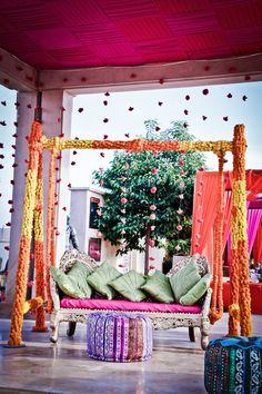 Mehendi jhoola decor with marigolds