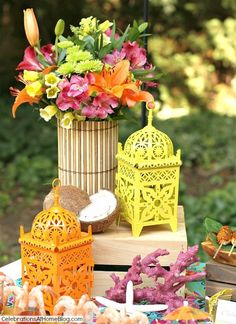 tropical party centerpiece. Bamboo placemat wrapped around vase.